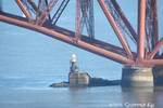 Image of Inchgarvie Lighthouse under the Forth Bridge