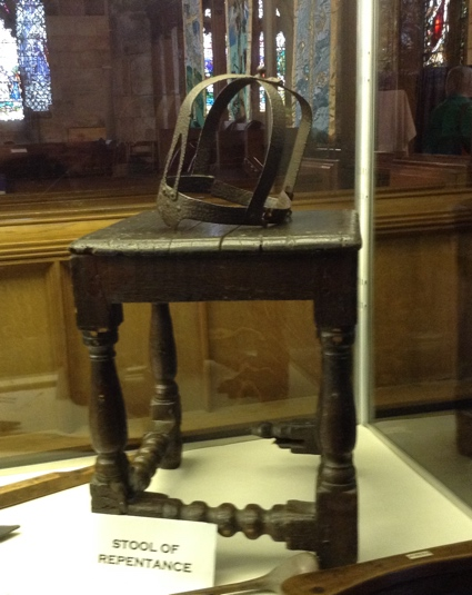 Image of old stool and metal helmet