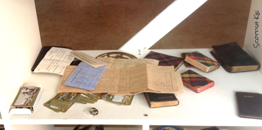 Image of certificates and memorabilia on shelf in shop window